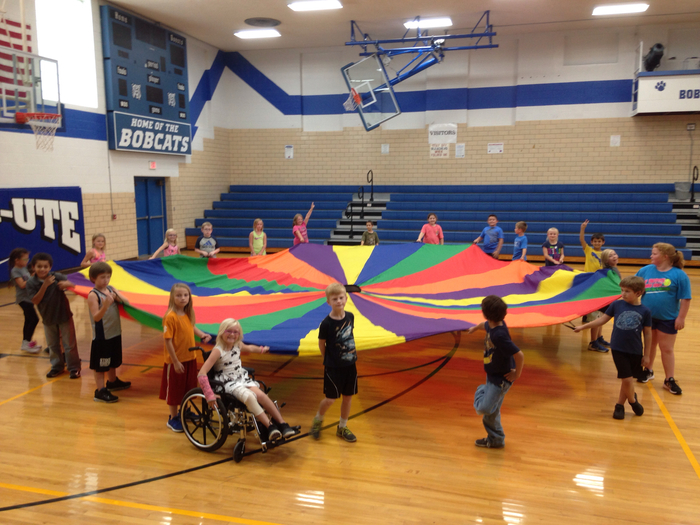 3rd grade having fun with the parachute